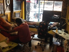 Friends getting tattooed together